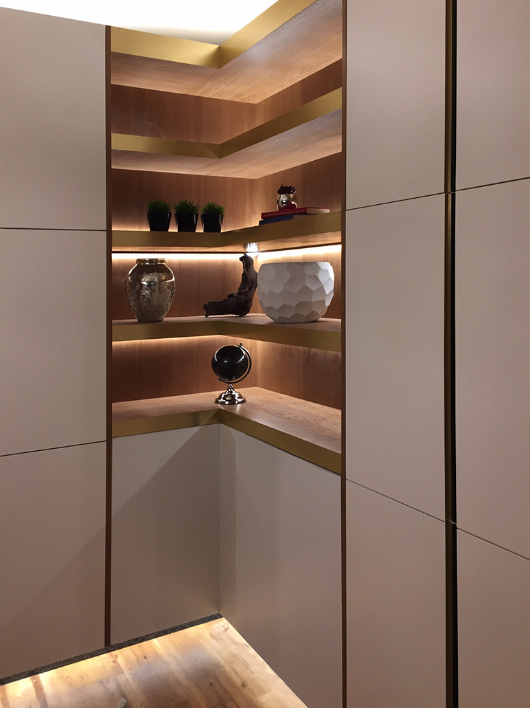 Shelving units with minimal decoration and hidden lighting - Show Flat Interior Design ideas from Spot This Space