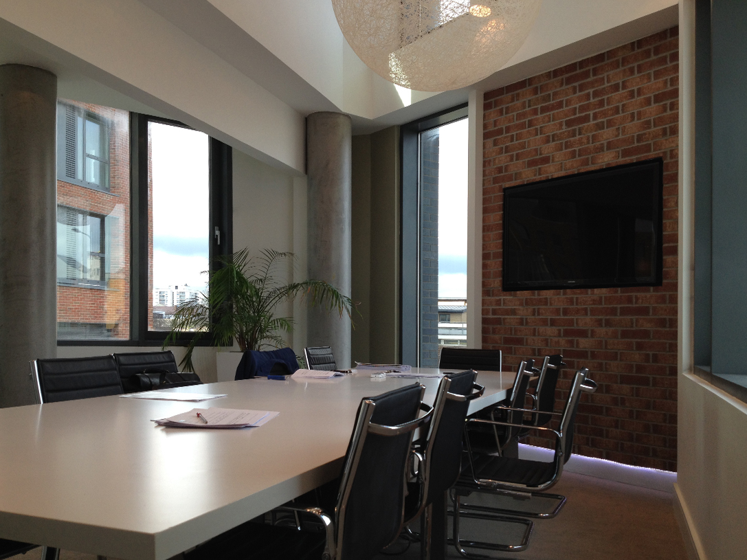Exposed brick wall for a meeting room interior design